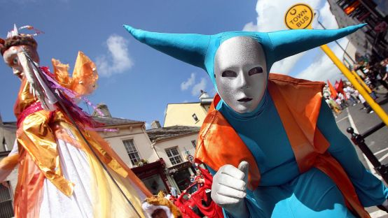 Image of silver faced man in street carnival