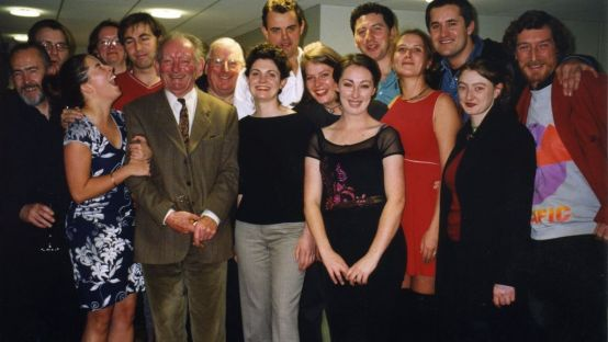 Brian Friel with the cast and crew of An Grianán Theatre's production of Translations in 1999.