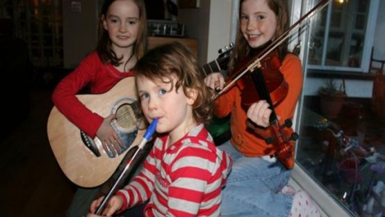 Image of 3 young Students holding instruments