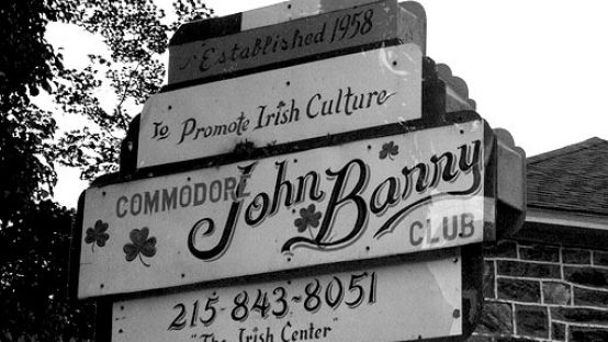 black and white image of sign for Commodore John Barry Irish Club