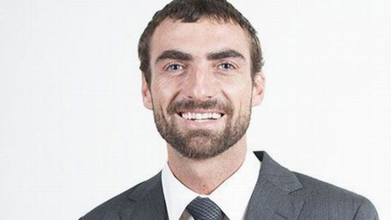 Image of Dermot Doherty smiling  in a suit