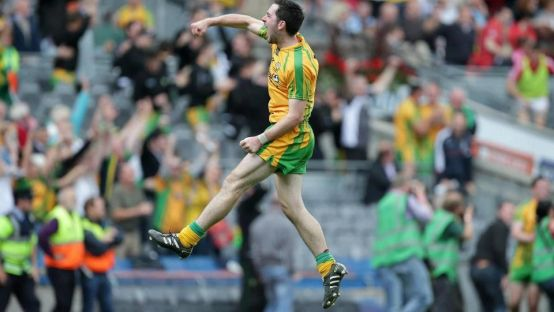 Image of Donegal player jumping for joy.