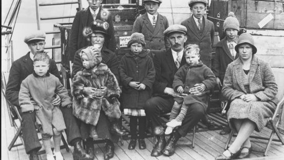 Black and White Image of people seated on a ship