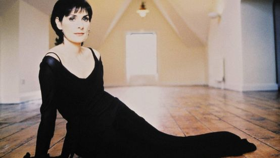 Picture of Enya on wooden floor in black dress