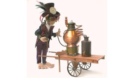 Image of a felt toy figure with a portable poitín distillery
