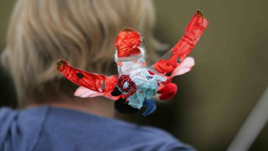 Image of Child holding a paper craft