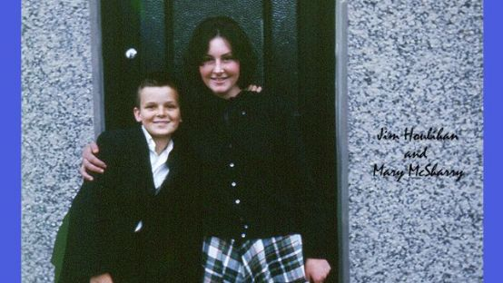 Image of young boy and girl, hugging in a door way