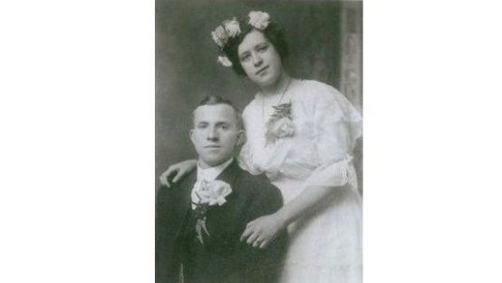 Old black and white photo of Owen and Ellen McDevitt in fine dress