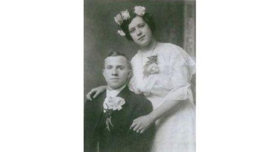 Old black and white photo of Owen and Ellen McDevitt in fine dress