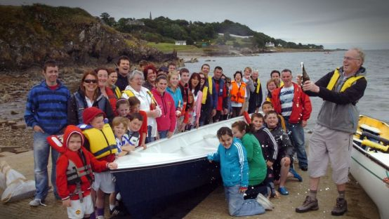 Image of group of people at the launch of the Celtic Longboat