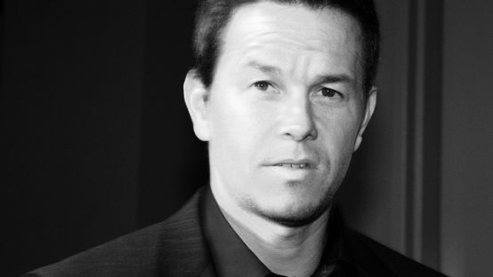 Black and white image of Mark Wahlberg in a suit