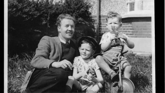 Black and White image of Ray with two small children
