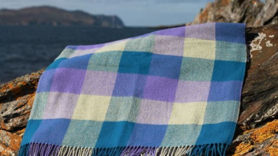 Picture of a checked tweed rug on rocks