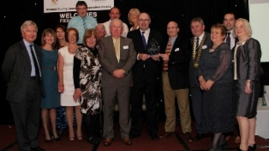 Image of group of people standing at Ireland Pride of Place Awards