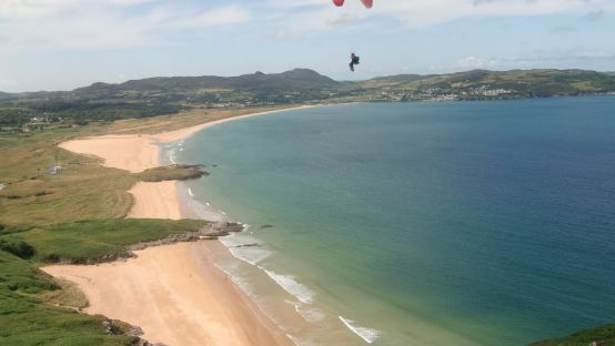 Image of someone paragliding over Ballymastocker Bay, Donegal