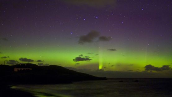 Image of green and purple aurora in the sky