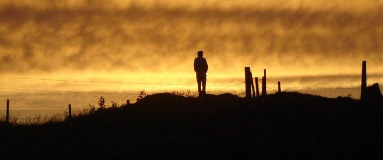 image of figure on a hillside