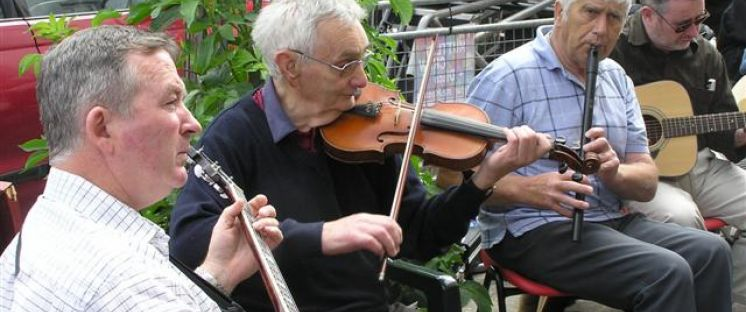 Image of 4 musicians playing on the street