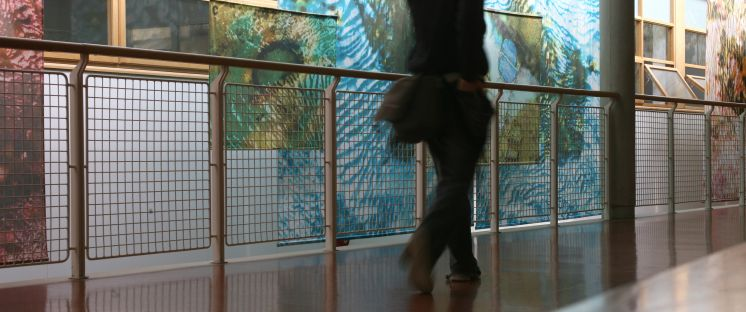 Image of girl walking in a corridor in LYIT