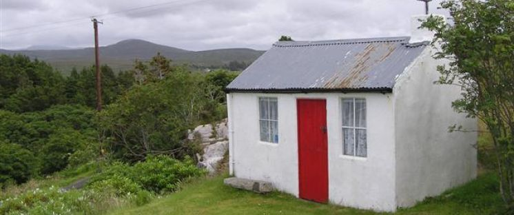 IMage of small house with red door
