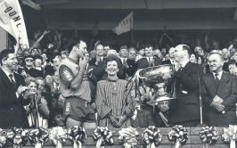 Image of Donegal player Celebrating the first All-Ireland victory with the President Mary Robinson