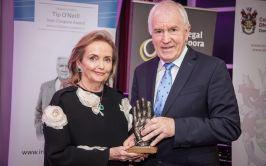 Minister Jimmy Deeninhan presents the Award to Loretta Brennan Glucksman