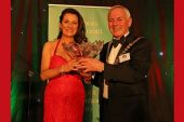 Deirdre McGlone being presented with her award by Hugh Harkin, President of the Association
