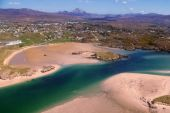 Aerial view of Gweedore with sand and blue green water