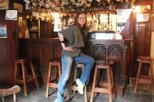Image of woman sitting on a bar stool
