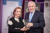 Minister Jimmy Deeninhan presents the Award to Loretta Brennan Glucksman
